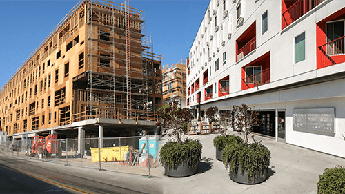 Blended before and after pictures of One Santa Fe, an LADF funded mixed-use, live-work project