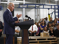 Vice President Joe Biden, right, speaks to staff during a visit at the Bobrick Washroom Equipment Factory in Los Angeles on Wednesday, July 22, 2015. (AP Photo/Nick Ut)